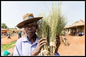 Man with broom at Agweng