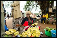 Street seller in Lira, the bananas are yummy and each hand was about 50 cents.