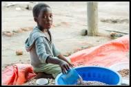 Kid selling beans in Gulu