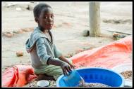 Kid selling beans in Gulu