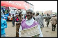 Buganda bus park and my friend the newspaper seller.