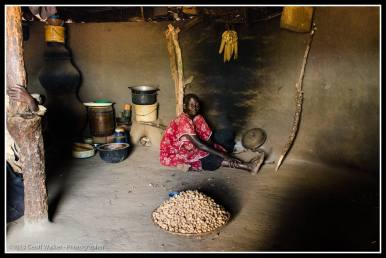 Gridning peanuts in big mama Jerodina's hut - Ludok Village
