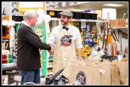 PnK People... Mr C. Kershaw congratulates a customer.