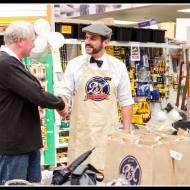 PnK People... Mr C. Kershaw congratulates a customer.