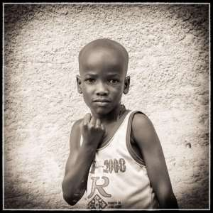 Young Acholi boy Arop Moses aged 7 years in Rackoko. Moses originates in Ludok Village, Odek subcounty, Gulu District, Northern Uganda and is being sponsored by a New Zealand couple.. there are many children who could use a sponsor... contact me via the ContacT Page.